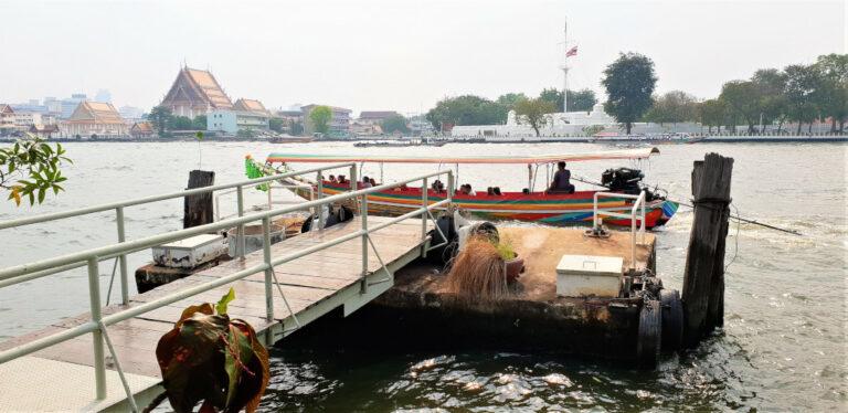 Boat taxi sailing on Chao Phraya river in Bangkok, Thailand