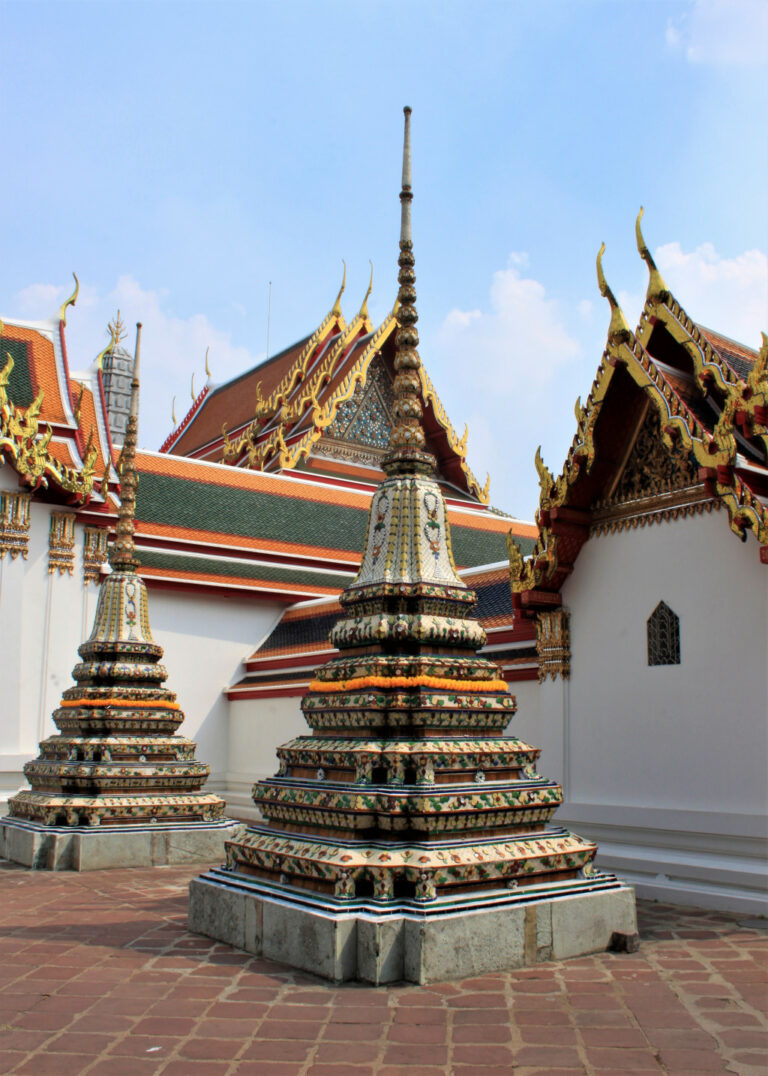 Stupas with colourful tiles and ceramics at Wat Pho, Bangkok