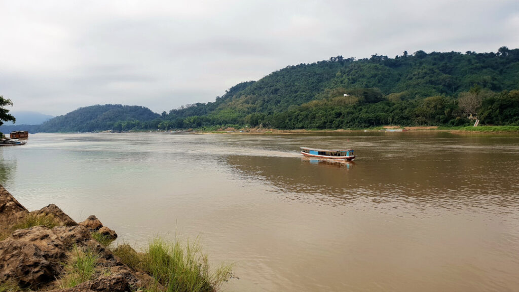 A boat sails on the Mekong river