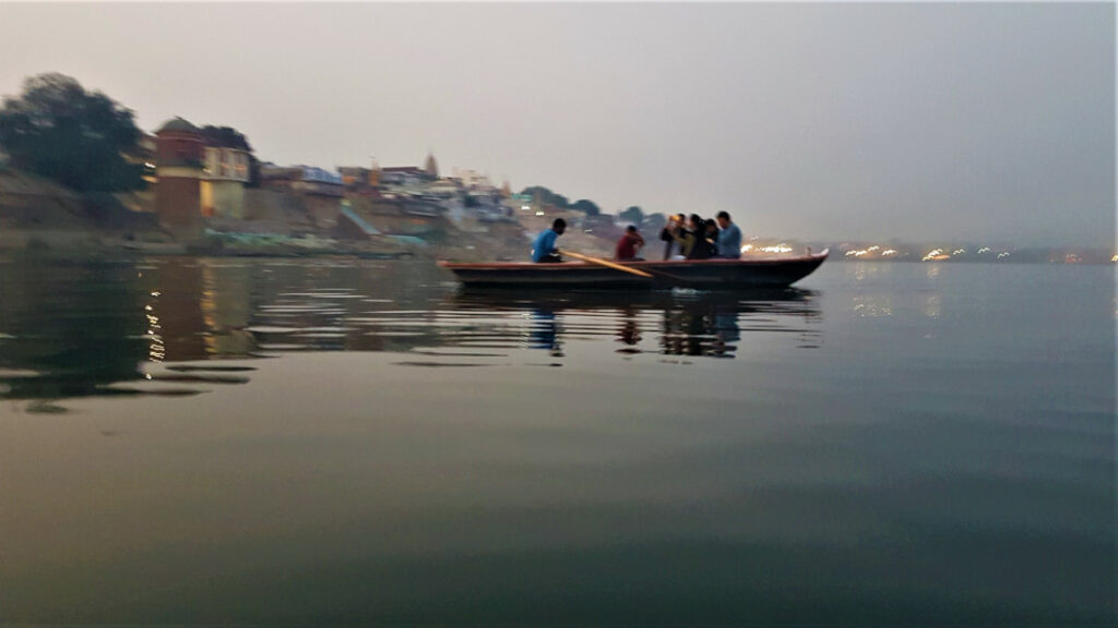 Tourists sailing on the Ganges