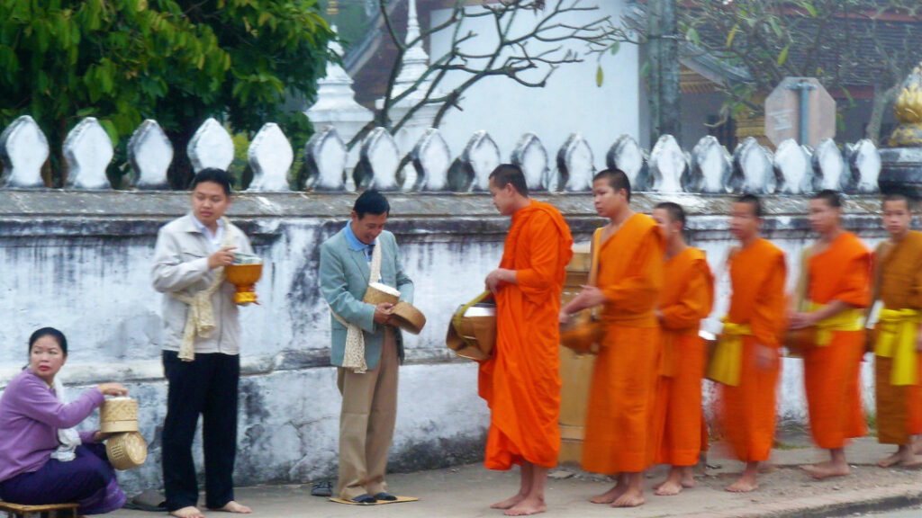 Monks wait patiently for their turn to be served