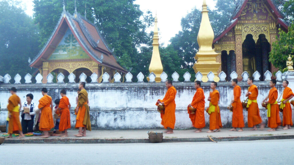 Monks, in order of seniority line up for alms