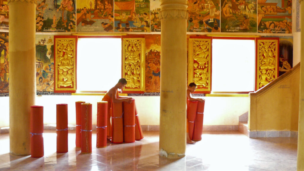 Young monks doing chore in the temple