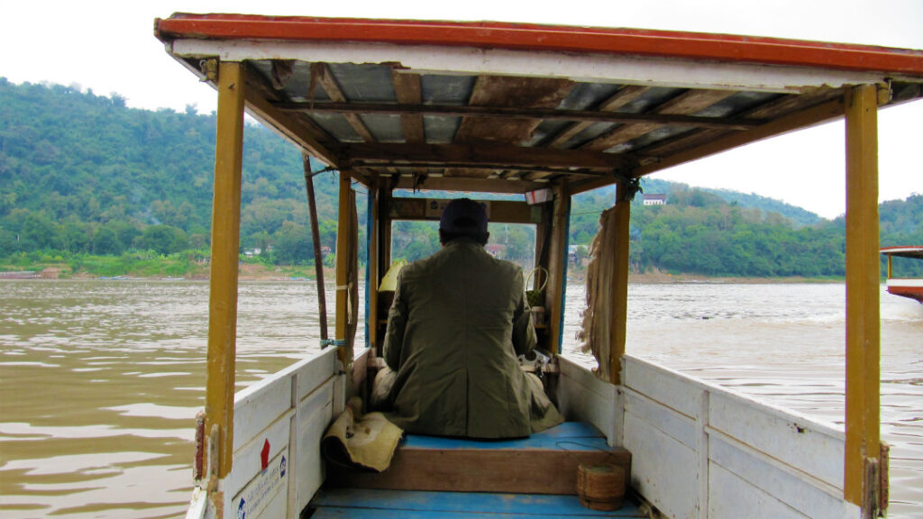 Take a boat ride to Pak Ou caves
