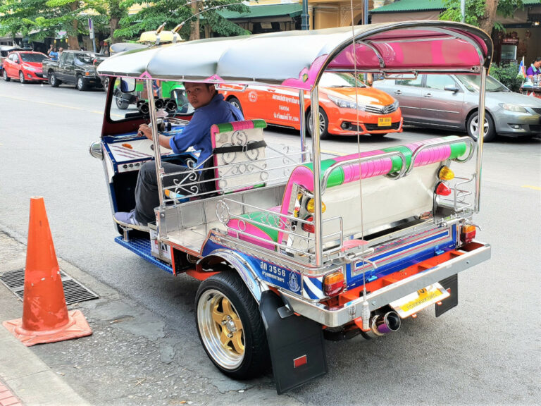 Tuk-tuk driver waiting for a passenger