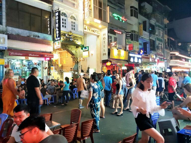 Bar girls enticing customers on Bui Vien Street in Saigon Vietnam