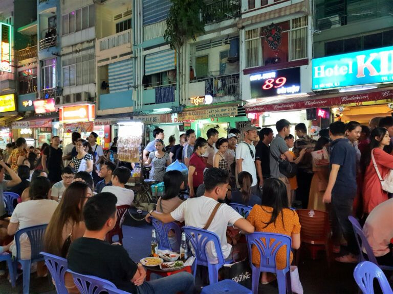 Crowded Bui Vien Street with tourists and locals in Saigon Vietnam