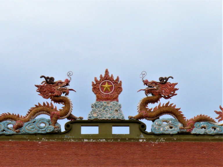 Red dragons with Vietnam symbol above the entrance into Ben Duoc memorial complex