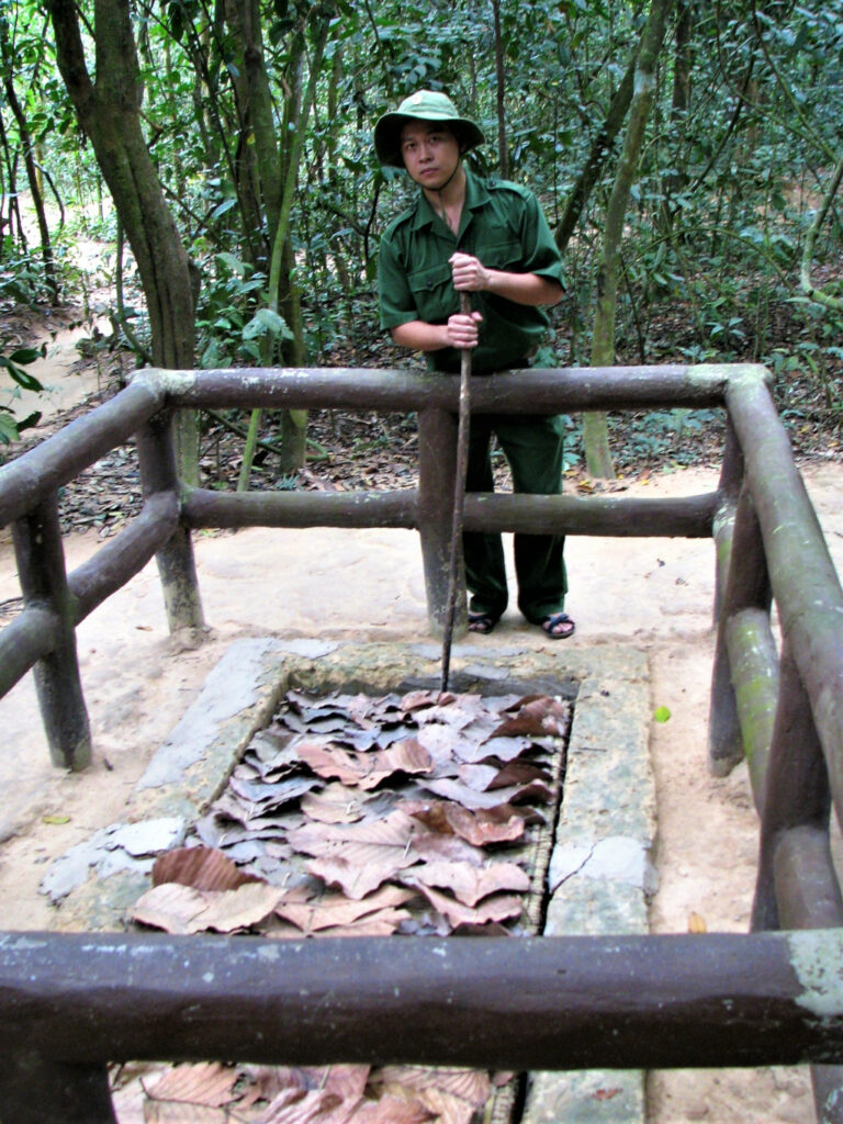 Guide showing how a booby trap worked at Cu Chi tunnels