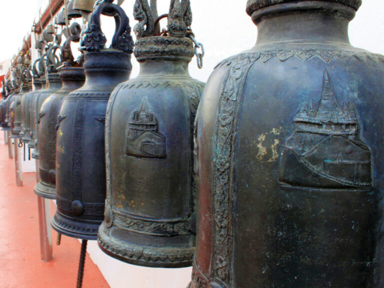 Many bells lined against the wall at the Golden Mount