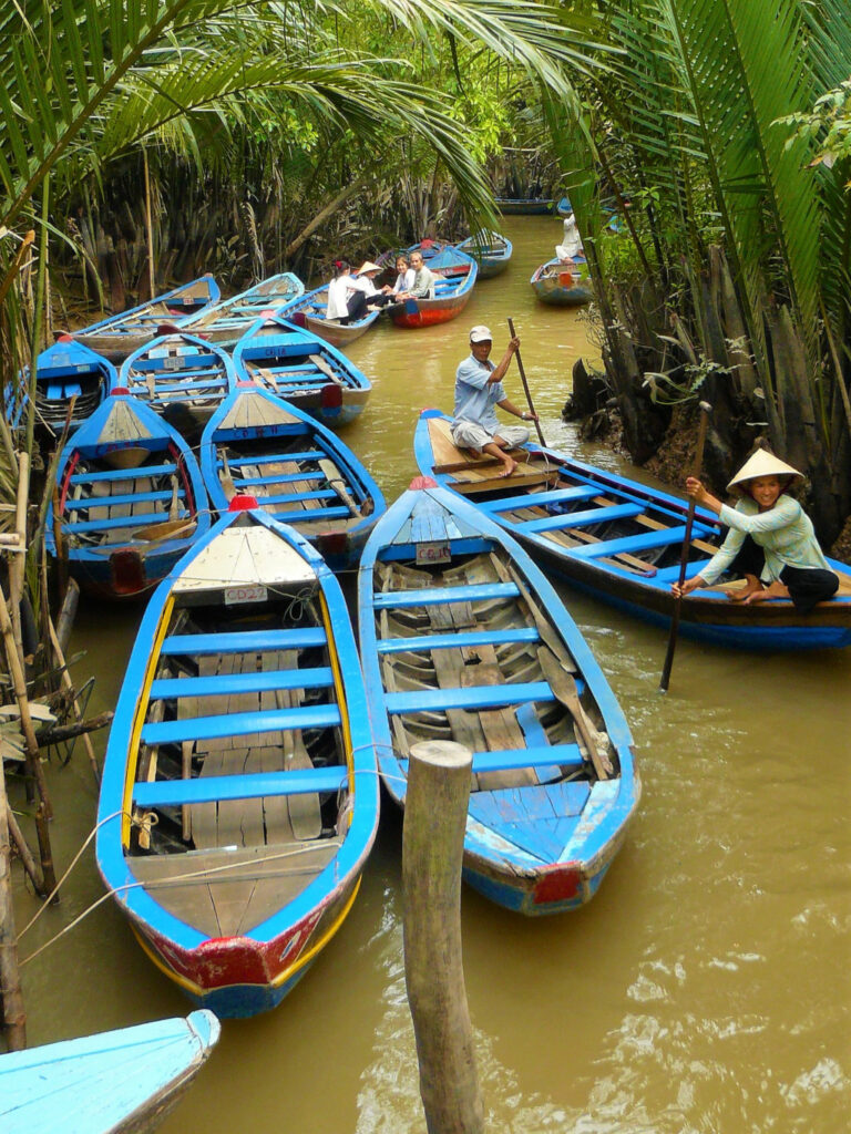 Sampans weaving their way past each other on the narrow canals in the Mekong Delta