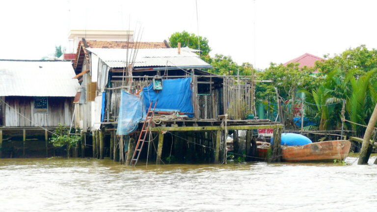 Floating home close to the mainland in Mekong Delta