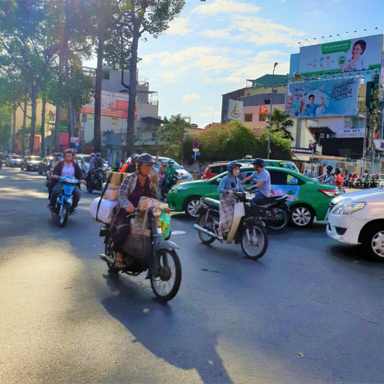 Motorbikes rushing by on busy street in Saigon, Vietnam