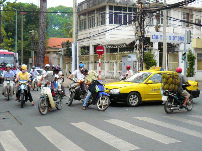 Taxi and motorbike in a road accident in Saigon, Vietnam