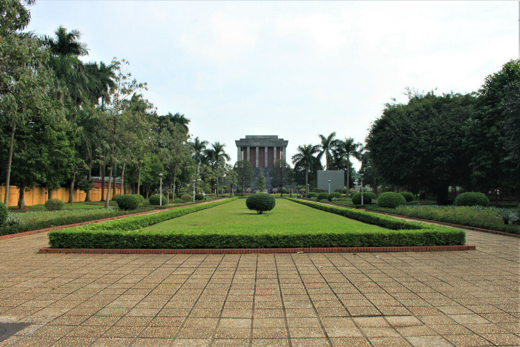 View of Ho Chi Minh Mausoleum from the side with a lawn in the foreground