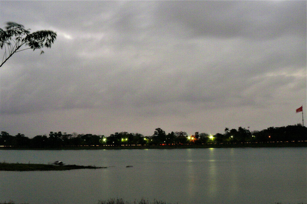 View of the Perfume river with Citadel flag fluttering late in the evening.