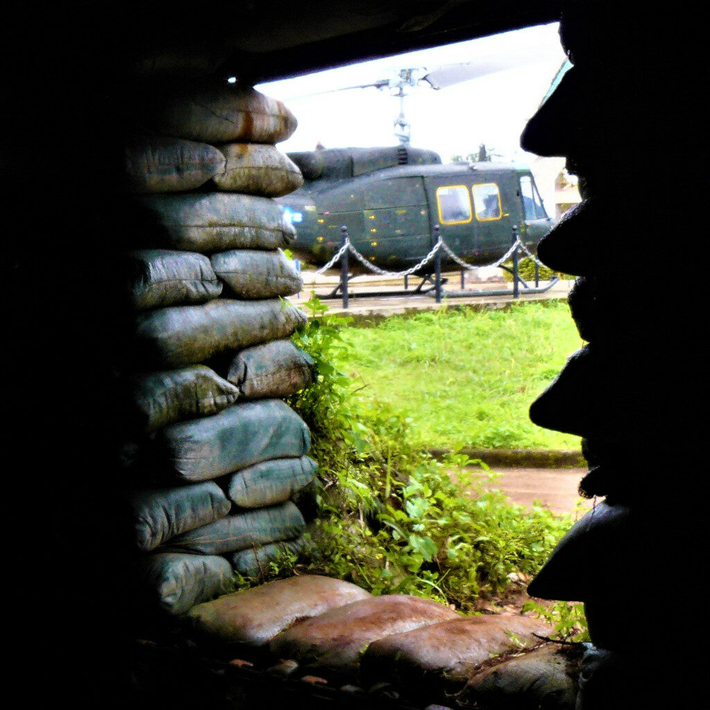 View of the museum with a helicopter from inside a bunker at Khe Sanh Combat Base