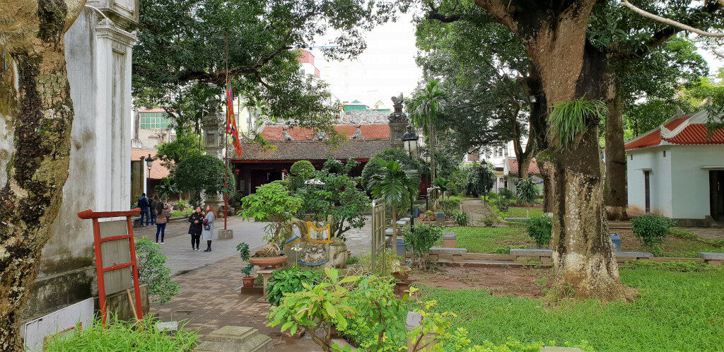 View of the courtyard within Quan Thanh temple with the shrine ahead