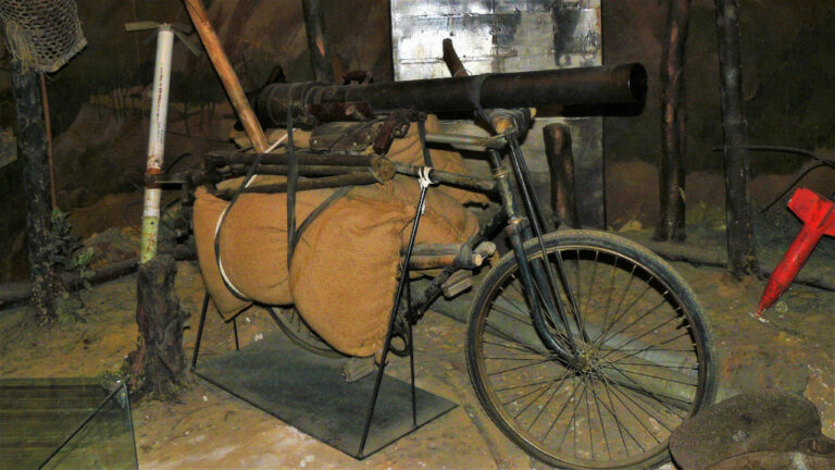 A bicycle with a mortar launcher mounted on it as part of the diorama at the Military Museum Hanoi