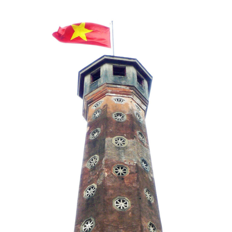 Flag tower at Vietnam Military Museum with flag fluttering