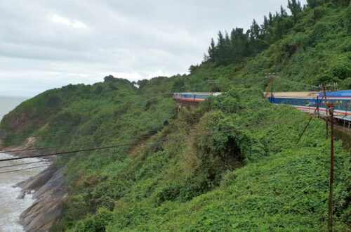 Reunfication Express train on its way to Danang which you can see in the background
