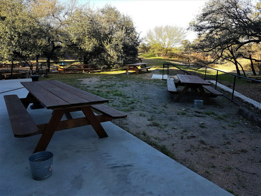 Outdoor picnic table and benches with shade