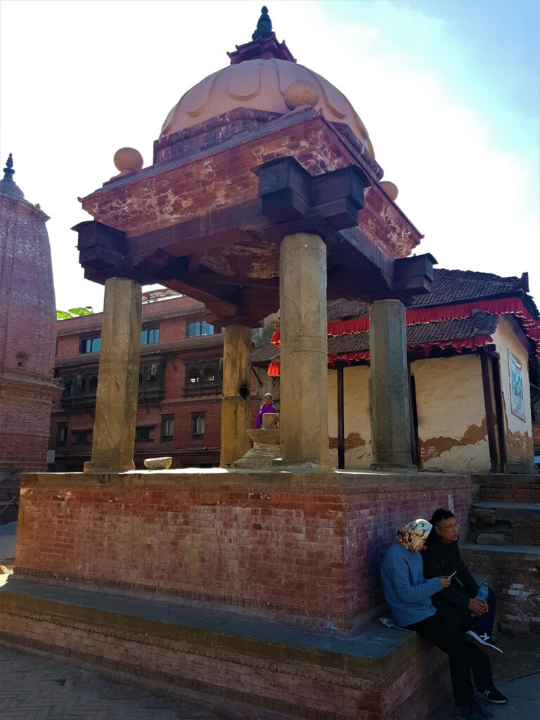 Relaxing under the shades of one of the smaller temples