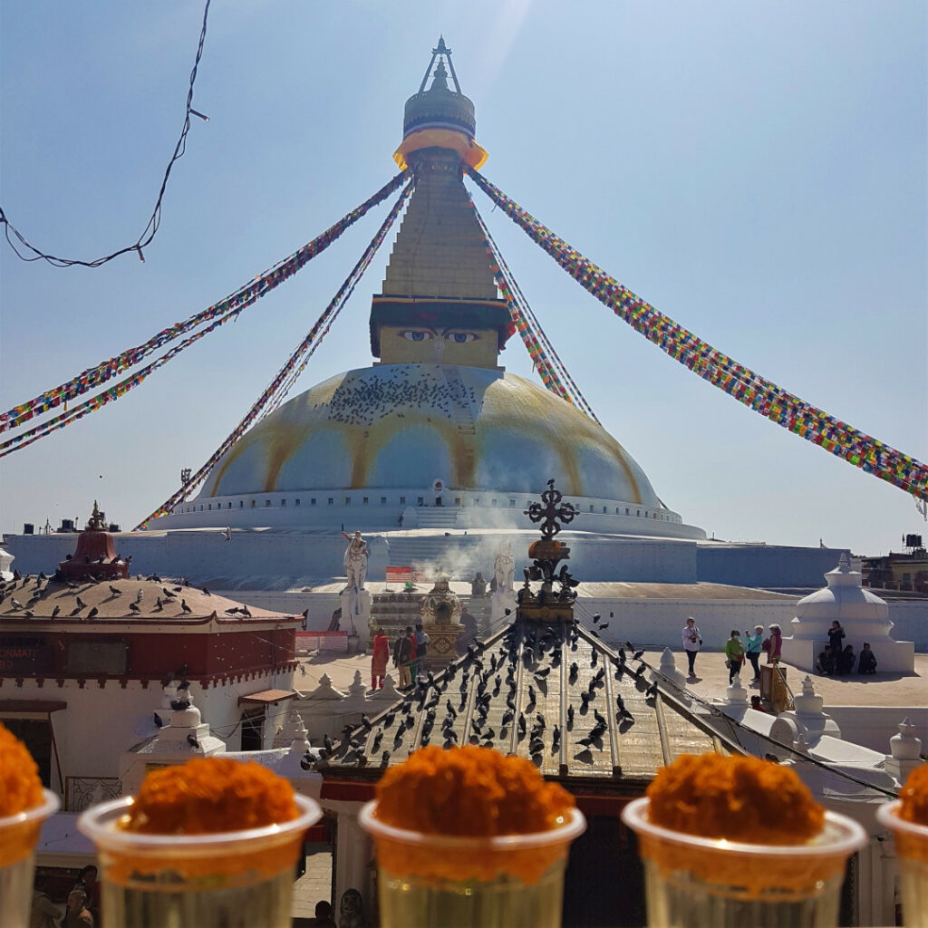 The Boudhanath Stupa with butter lamps in the foreground