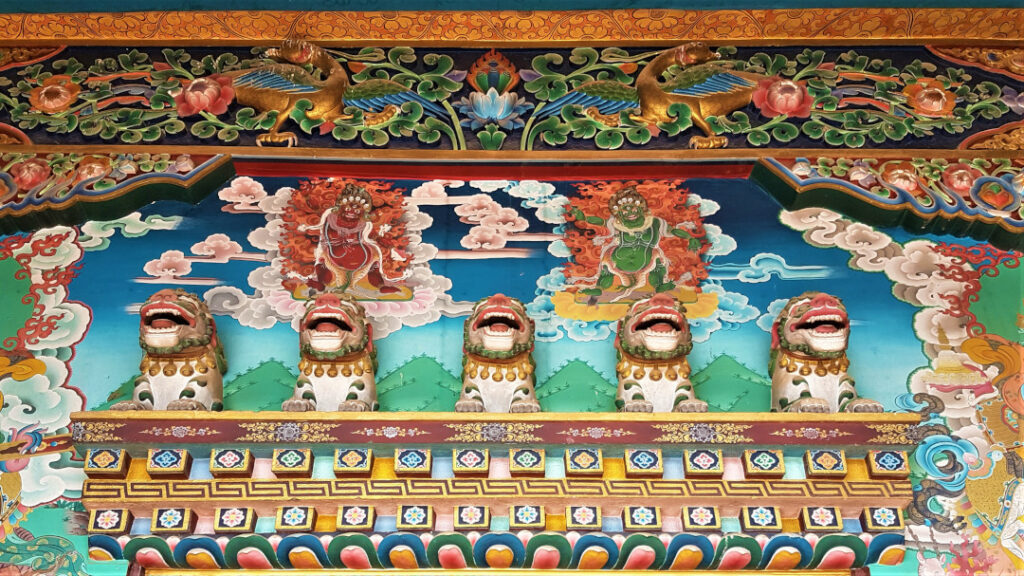 Engravings and murals at Lhakhang Monastery