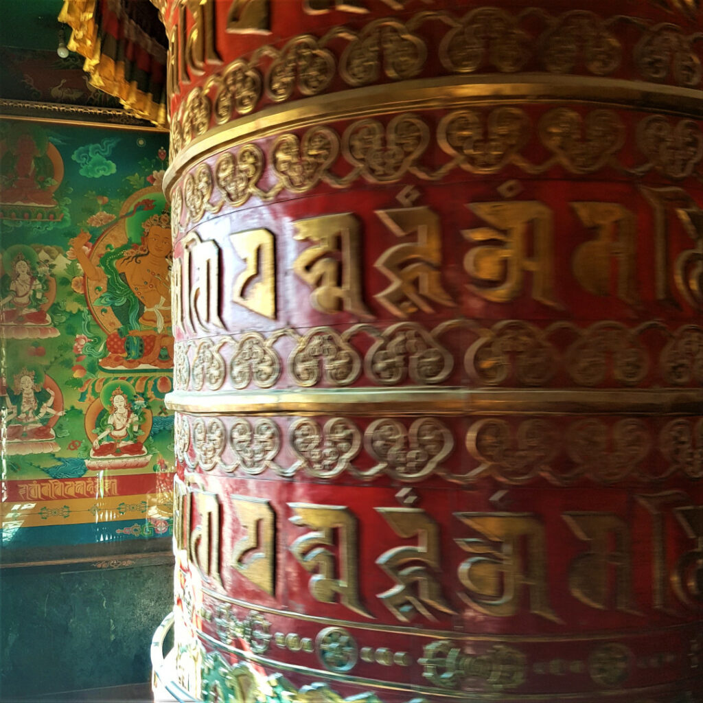 The giant prayer wheel inside the hall at Boudhanath