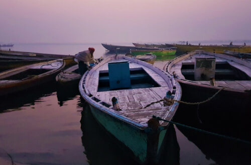 A boatman gets his boat ready for the day