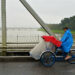 A rikshaw driver cycles his bike on the Truong Tien Bridge