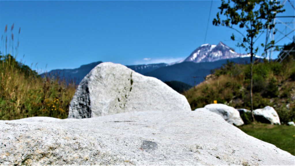 Garibaldi mountain in the background with a stone cliff in the foreground