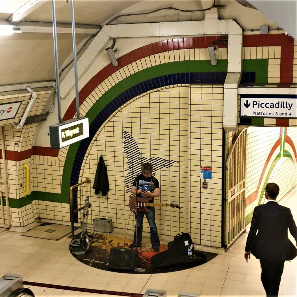 The rockstar busker inside Piccadilly Circus Station