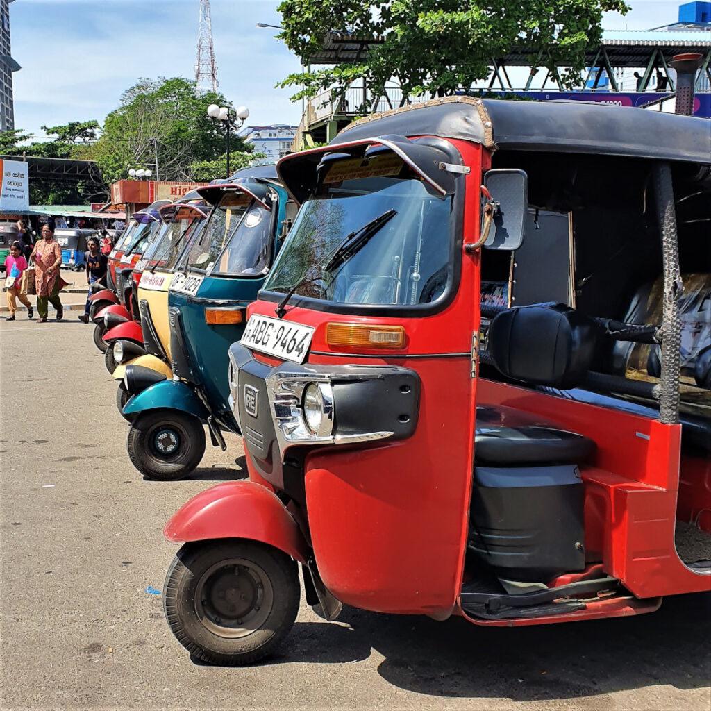 Tuk-tuks waiting for passengers