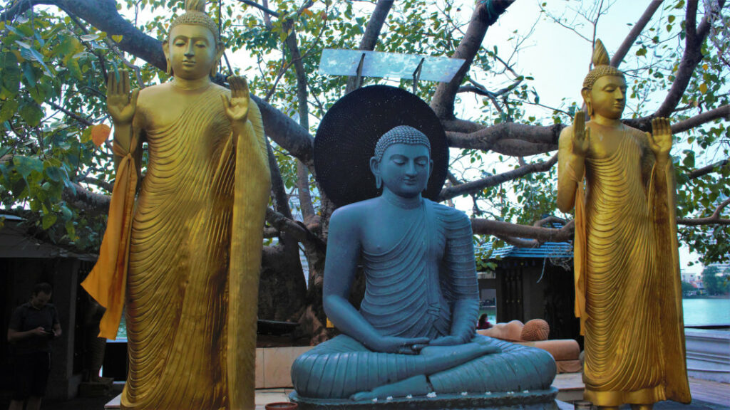 Statue of the Buddha with two of his disciples at Seema Malaka
