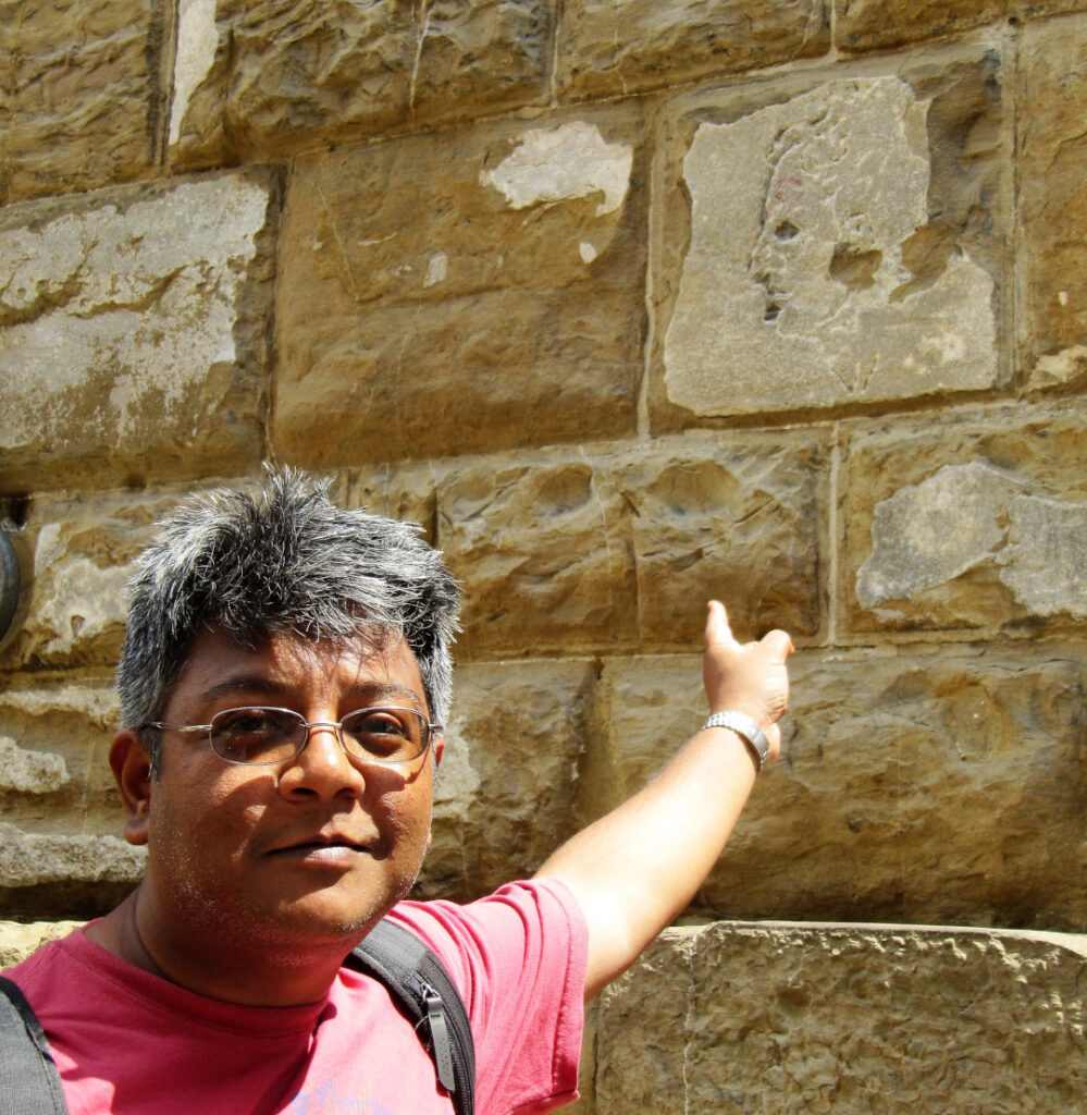 Posing in front of the stone brick