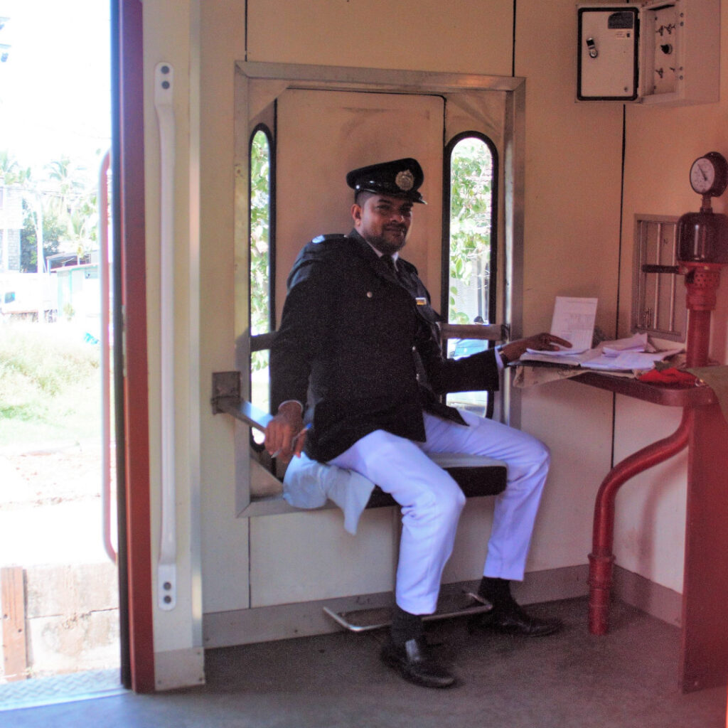 A train guard poses for the camera