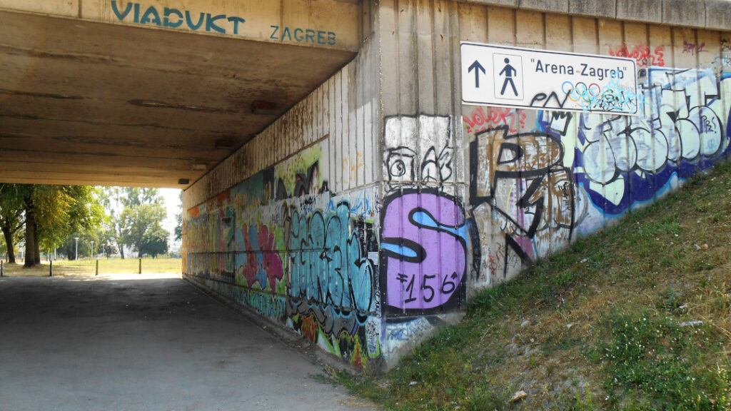 A graffiti painted tunnel under the highway
