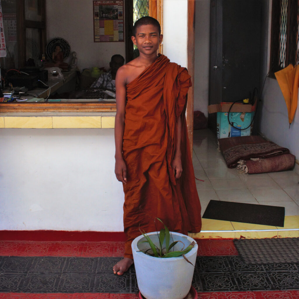 A young monk honours me with a smile for the camera