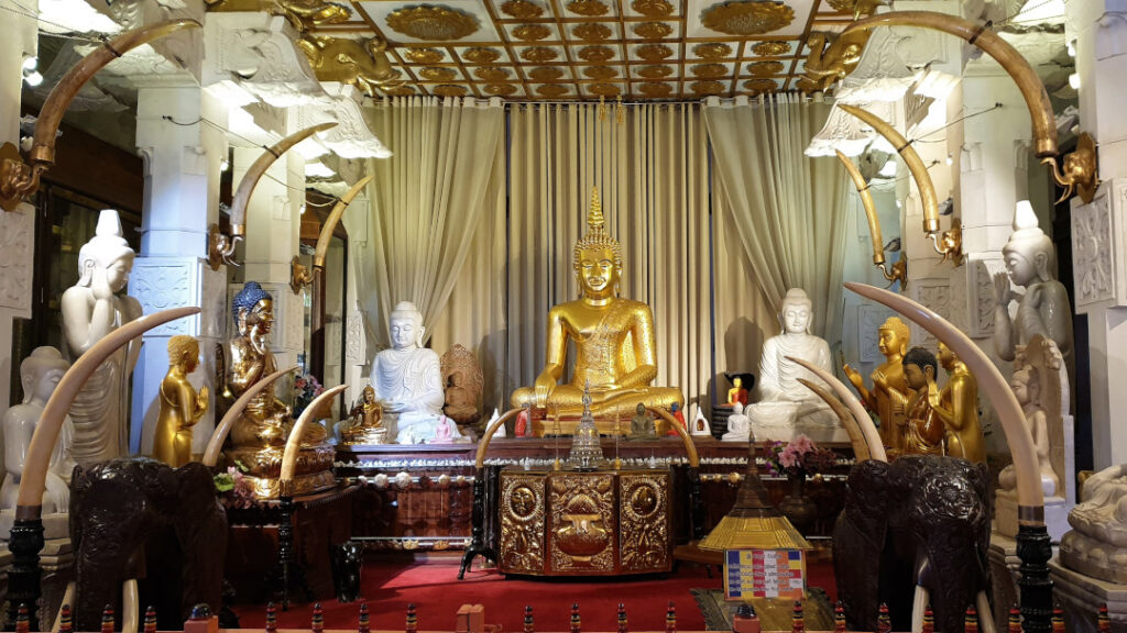 The statue of Buddha with ivory as adornments