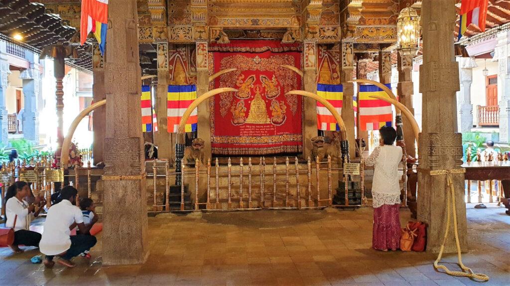 Devotees praying at the main shrine